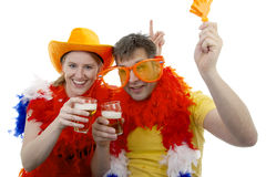 Twee Nederlandse voetbalventilators in oranje uitrusting Royalty-vrije Stock Foto's
