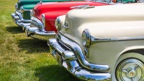Twee Oldsmobiles en Buick Stock Afbeelding