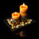 Twee oranje kaarsen Royalty-vrije Stock Afbeelding