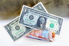 Twee oude dollars van de V.S. op een bos van nieuw rollen-op euro bankbiljetten Stock Foto
