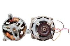 Twee oude elektrische die motoren op witte achtergrond worden geïsoleerd royalty-vrije stock afbeeldingen