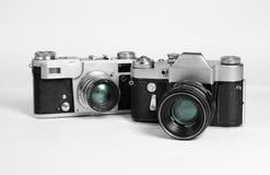 Twee oude filmfotoapparta Stock Foto's