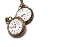 Twee oude horloges die op wit worden geïsoleerdb royalty-vrije stock fotografie