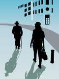 Twee personen met hoed het lopen Royalty-vrije Stock Afbeelding