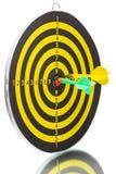 Twee pijltjes en bullseye Stock Afbeeldingen