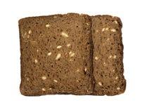 Twee plakken roosterden 100% roggebrood met zonnebloemzaden, zonder gist Stock Foto