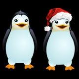 Twee pretpinguïn in de Kerstmanhoed en zonder het stock illustratie