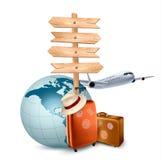 Twee reiskoffers, een vliegtuig, een bol en een richtingsteken. Stock Foto's