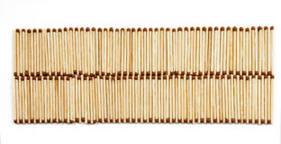 Twee rijen van vele gelijken op witte mening als achtergrond van hierboven Royalty-vrije Stock Foto