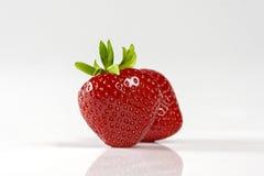 Twee rode aardbeien op witte achtergrond Stock Foto's