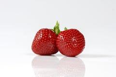 Twee rode aardbeien op witte achtergrond Royalty-vrije Stock Foto