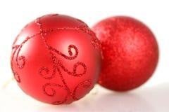Twee Rode Decoratie van Kerstmis Stock Foto's