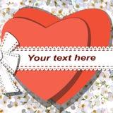 Twee rode die harten door lint met boog op achtergrond van tot bloei komende kers worden gebonden bloeit Stock Afbeelding