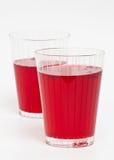 Twee rode dranken van het Amerikaanse veenbesfruit Stock Fotografie