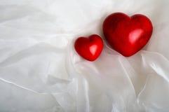 Twee rode harten Stock Foto's