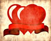 Twee rode harten op perkamentachtergrond Stock Afbeeldingen