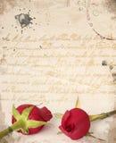 Twee rode rozen uitstekende kaart Stock Afbeeldingen