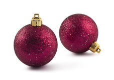 Twee rode snuisterijen van Kerstmis Stock Foto
