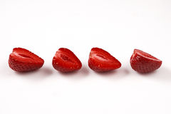 Twee rode verse gewassen aardbeien op witte achtergrond Sluit omhoog macrofoto Royalty-vrije Stock Afbeelding