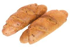 Twee roggebroodjes met graangewassen Stock Afbeeldingen