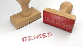 Twee rubberdiezegels met het woord op witte verwerping wordt ontkend concep Stock Afbeelding