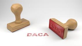Twee rubberzegels met het woord DACA en een zegel op wit Stock Foto's