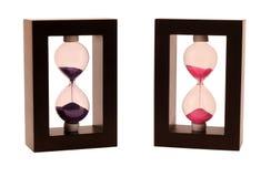 Twee sandglass op een witte achtergrond Royalty-vrije Stock Afbeeldingen