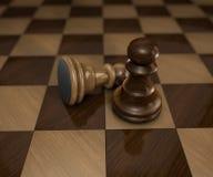 Twee schaakstukken op geruite raad Royalty-vrije Stock Afbeeldingen