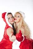 Twee sexy meisjes die van de Kerstman pret hebben Stock Foto's