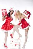 Twee sexy meisjes die van de Kerstman pret hebben Stock Afbeelding