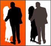 Twee silhouetten van een paar Stock Afbeeldingen