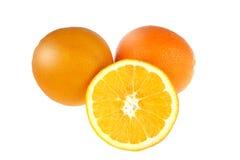 Twee sinaasappelen en één plak Royalty-vrije Stock Afbeeldingen
