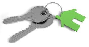 Twee sleutels en een huismarkering Royalty-vrije Stock Afbeeldingen