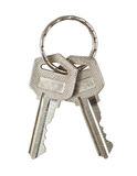 Twee sleutels met metaaldiering op wit wordt geïsoleerd. knippende weg. Royalty-vrije Stock Afbeelding