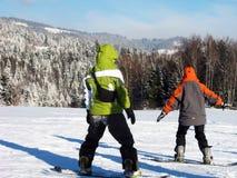 Twee snowboardbeginners Stock Afbeelding