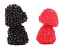 Twee stapels van geleifruit in de vorm van het bessensuikergoed. royalty-vrije stock afbeeldingen