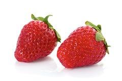 Twee starwberries op wit Stock Foto's