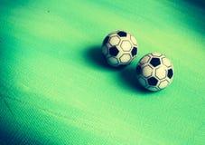 Twee stuk speelgoed voetballen Stock Afbeelding