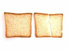 Twee stukken van wit toostbrood zijn op een witte achtergrond royalty-vrije stock foto's