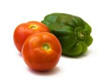 Twee tomaten en groene paprika Royalty-vrije Stock Fotografie