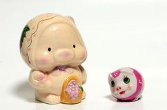 Twee varkensspeelgoed Stock Afbeeldingen