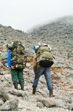 Twee vermoeide backpackers Royalty-vrije Stock Foto