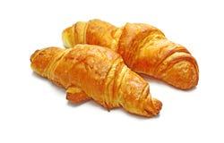 Twee verse croissant, gietende zachte schaduw op wit. Stock Afbeelding
