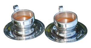 Twee verzilverde koppen van koffie Stock Afbeeldingen