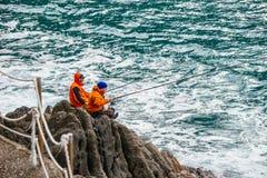 Twee vissers visserij Stock Afbeelding