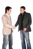 Twee vriendenhanddruk Stock Foto's
