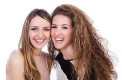 Twee vrouwelijke geïsoleerde vrienden Stock Foto