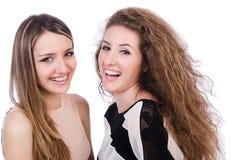 Twee vrouwelijke geïsoleerde vrienden Stock Foto's