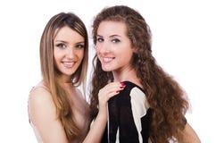Twee vrouwelijke geïsoleerde vrienden Stock Afbeelding