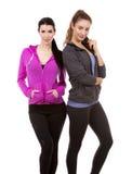 Twee vrouwelijke vrienden op witte achtergrond Stock Foto's